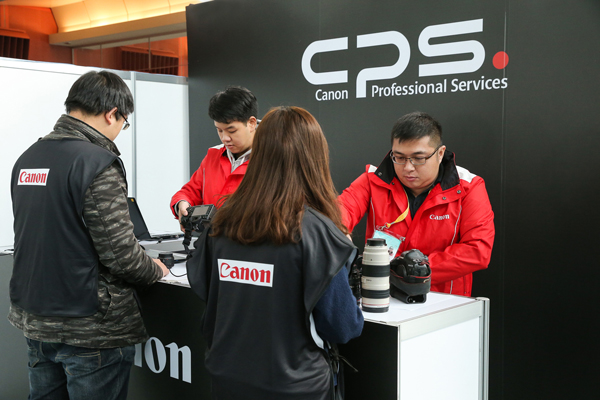 A Canon camera service booth provides support during a recent sporting event