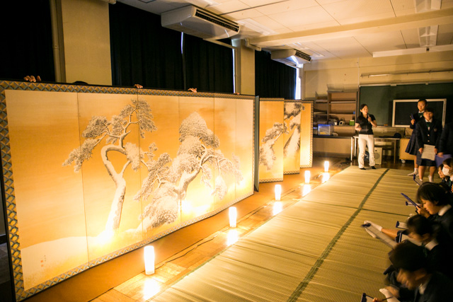 Students view the folding screens